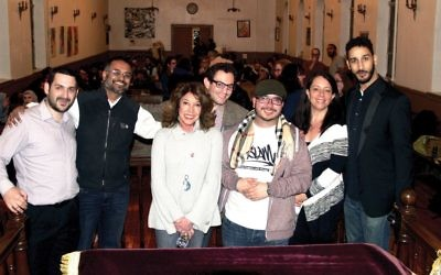 From left, CKI Rabbi Sam Reinstein with performers Mansoor Basha, Sandi Marx, Eli Reiter, Dennis Sadik Kirschbaum, Amy Klein and Aymann Ismail. courtesy of Eyal Solomon