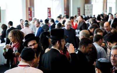 "The scene at last month's Kosher Food and Wine Experience, which drew 2,500 foodies and oenophiles to Chelsea Piers. ""Everybody is looking here to find out what's new in the world of kosher wine,"" says Royal Wine's Nathan Herzog. Photos by Tzvi Simcha/Royal Wine Corp."