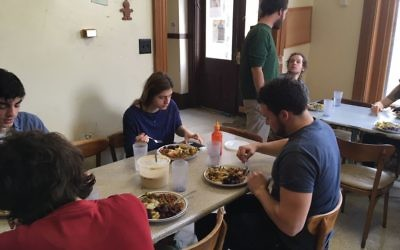 Sharing a meal at Oberlin's Kosher Hallal Co-op. Photos courtesy of Kosher Hallal Co-op.