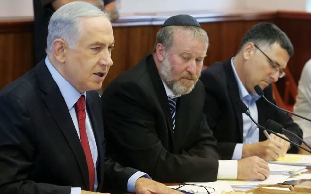 The political fate of Prime Minister Benjamin Netanyahu, left, may rest with Attorney General Avichai Mandelblitt, center. GETTY IMAGES