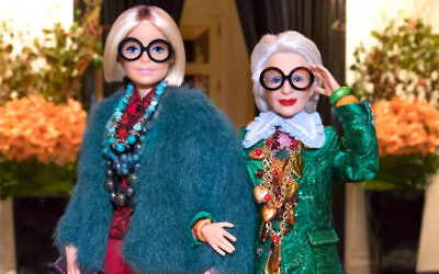 A Barbie doll in the image of Iris Apfel, right. (Courtesy of Mattel Inc.)