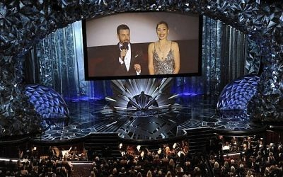 Host Jimmy Kimmel, left, and Gal Gadot appear on screen via satellite at the Oscars on Sunday, March 4, 2018, at the Dolby Theatre in Los Angeles. (Photo by Chris Pizzello/Invision/AP)