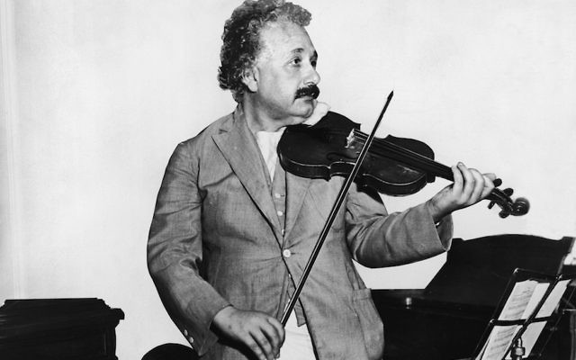 Albert Einstein shown playing a violin in 1931. (Keystone/Getty Images)