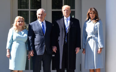President Donald Trump and wife Melania, right, pose with Israel Prime Minister Benjamin Netanyahu and wife Sara outside the Oval Office of the White House, March 5, 2018. (Olivier Douliery-Pool/Getty Images)