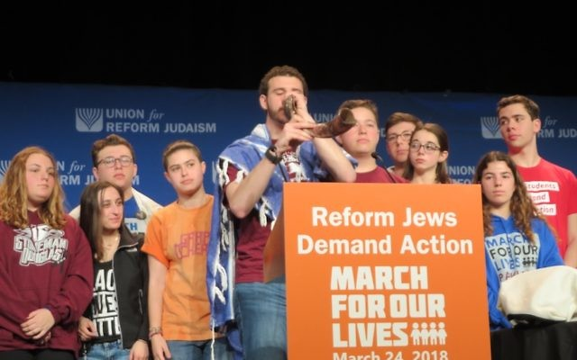A NFTY activist blowing a shofar before the March for Our Lives march against gun violence in Washington D.C., March 24, 2018. JTA