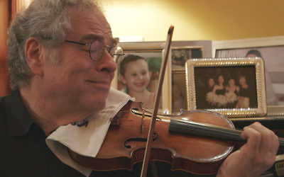 """Itzhak Perlman, shown in a scene from the documentary """"Itzhak,"""" has endured hardships to become perhaps the most famous violinist in the world. (Courtesy of Greenwich Entertainment)"""