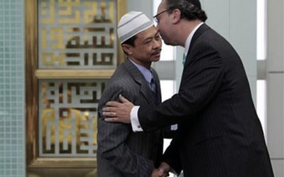 Imam Muhammad Shamsi Ali, left, of the Islamic Cultural Center of New York, and Rabbi Marc Schneier, the president of The Foundation for Ethnic Understanding and founding rabbi of The New York Synagogue, greet each other after a payer service at the center in New York,  Thursday, May 21, 2009. After the prayer service, they joined together to condemn the alleged plot by four men arrested after planting what they thought were explosives near two New York City synagogues. Courtesy of The Foundation for Ethnic Understanding