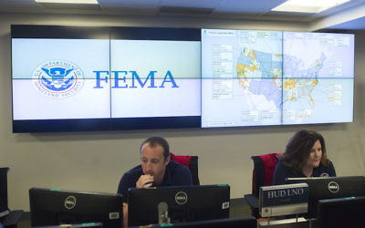 Employees inside the FEMA Command Center in Washington, D.C., Aug. 4, 2017. (Saul Loeb/AFP/Getty Images)