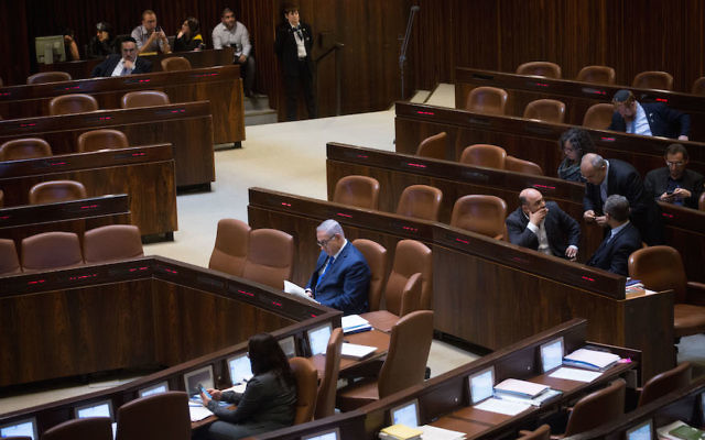 Prime Minister Benjamin Netanyahu seen in the Israeli parliament during a plenum session, March 12, 2018. (Miriam Alster/Flash90)