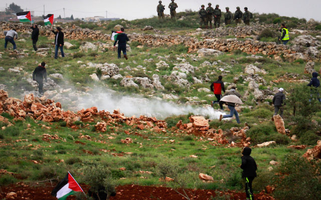 Palestinian protesters clashing with Israeli troops during a protest marking Land Day, in the West Bank city village of Qusra near Nablus, March 30, 2018. JTA