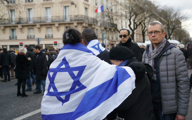 Jews at a march in Paris in memory of Mireille Knoll, March 28, 2018. (Cnaan Liphshiz)