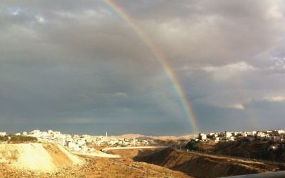 Rainbow's arc: Overlooking the village of Isawiyya, which is on the Israeli side of the security border.  Sarah Halevi