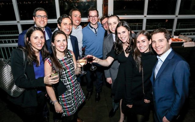 Nicole Pines Lieberman (above left, with a wine glass), an immediate past co-chair of New York Next Generation, joins family members in a toast to her maternal grandfather, Murray Pantirer, a Holocaust survivor saved by Oskar Schindler and a founder of the U.S. Holocaust Memorial Museum. Courtesy of Michael Priest Photography