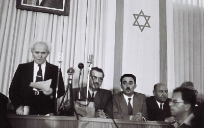 David Ben-Gurion, who was to become Israel's first prime minister, reads the new nation's Declaration of Independence in Tel Aviv, May 14, 1948. (Zoltan Kluger/Israeli Government Press Office via Getty Images)