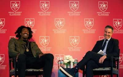 Amar'e Stoudemire, left, speaking with Jon Frankel Sunday at the Israel Summit at Harvard University in Cambridge, Mass. Collin Howell/Israel Summit at Harvard