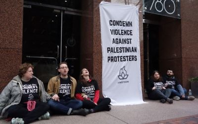 Demonstrators blocks the doors of the building that houses the NYC office of US Senator Chuck Schumer April 9, 2018 in New York. Eight American Jewish youth were arrested for blocking the doors of Schumers New York City office for 90 minutes as they called on him to condemn Israeli reaction to the protests on the Israel-Gaza border. Getty Images