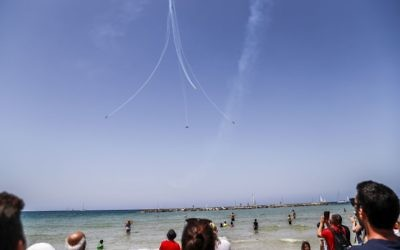 Israelis and tourists watch an air show during the festivities of the 70th Independence Day, on April 19, 2018 in Tel Aviv. Getty Images