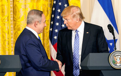 Israeli Prime Minister Benjamin Netanyahu, left, and President Donald Trump shaking hands after a joint news conference at the White House, Feb. 15, 2017. (The Asahi Shimbun via Getty Images)