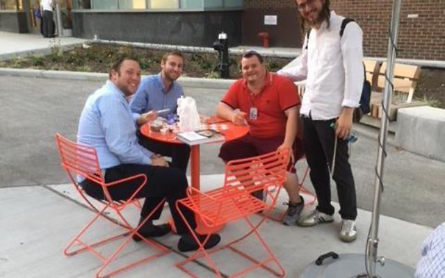 """Yonah """"JJ"""" Goldstein with friends. Courtesy of Makor"""