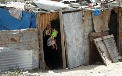 A Palestinian woman and child in a Gaza refugee camp. Some 65 percent of Gazans live in poverty. Getty Images