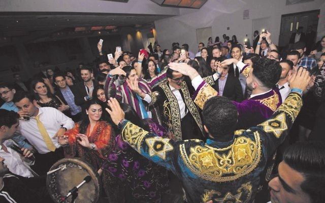 """Bukharian Jewish students celebrate at """"Night in Bukhara,"""" a Hillel cultural heritage program that included Bukharian comedy, food, music and dancing. Courtesy Queens College Hillel"""