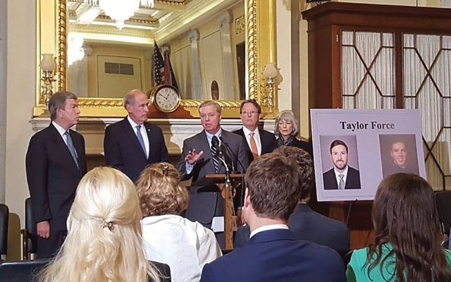 The Taylor Force Act being introduced by GOP Sens. Roy Blunt, Dan Coats and Lindsey Graham in 2016. Taylor Force's father, Stuart Force, is at center right. Twitter via JNS.org