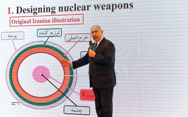 "In a dramatic presentation on Israeli TV Monday, Prime Minister Netanyahu disclosed what some are calling a ""stunning achievement"" — Israel's theft of 55,000 pages of records and another 55,000 files on 183 CDs related to Iran's nuclear program. Getty Images"