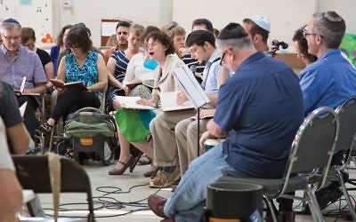 """""""Grassroots"""" service and dinner at Selah, a program at Congregation Agudas Achim in Austin, Texas, that caters to millennials """"searching for meaning.""""  Courtesy of Nina Miller"""