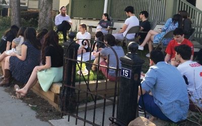 Students gather at Princeton's Chabad House to listen to a talk by Rabbi Eitan Webb. Gitty Webb
