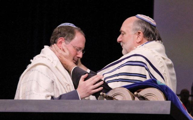 Rabbi David Ellenson blessing Rabbi Aaron Panken at the Union for Reform Judaism's biennial convention in 2013. Courtesy of HUC