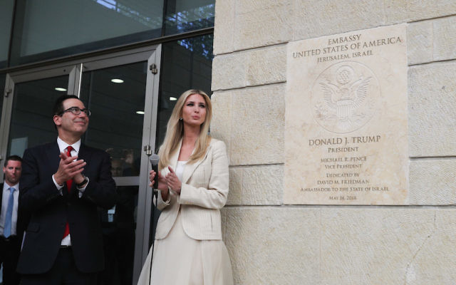 Steven Mnuchin, U.S. Secretary of the Treasury, and Ivanka Trump, adviser to and daughter of President Donald Trump, revealing a dedication plaque at the official opening ceremony of the U.S. Embassy in Jerusalem, May 14, 2018. (Yonatan Sindel/Flash90)