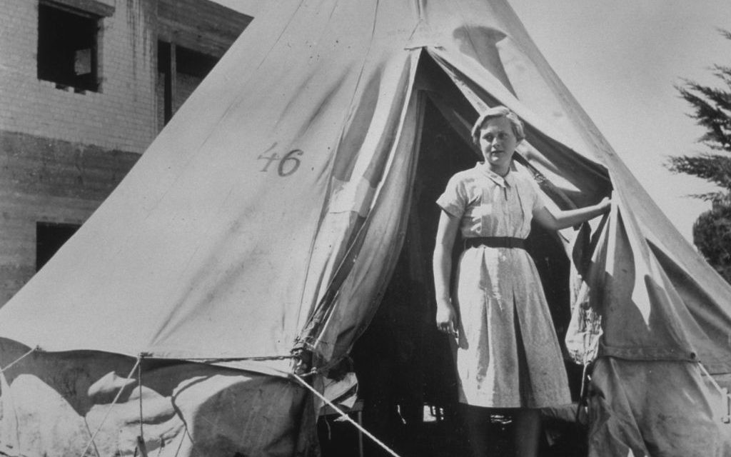 Illustrative photo of an early kibbutz, circa 1948. A Jewish girl stands in front of her tent, near Afula, where a new kibbutz had just been established. Getty Images