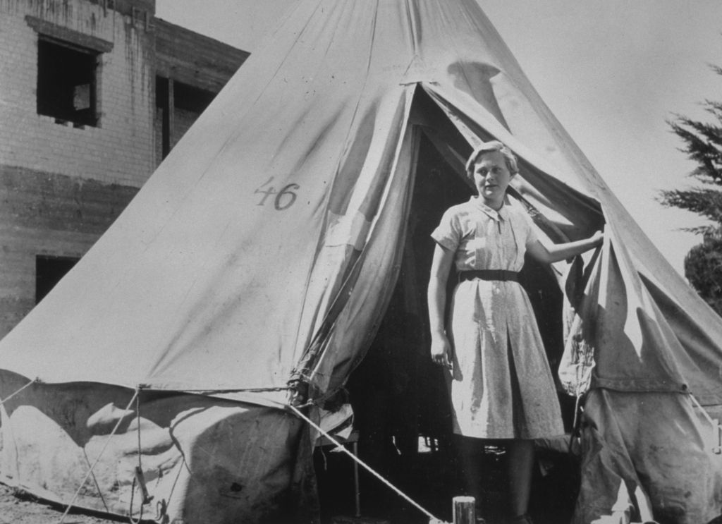Illustrative photo of an early kibbutznik, circa 1948. A Jewish girl stands in front of her tent, near Afula, where a new kibbutz had just been established. Getty Images