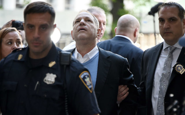 Harvey Weinstein arrives for his arraignment at a New York City courthouse in handcuffs, May 25, 2018. Getty Images