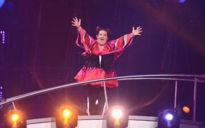 """Singer Netta Barzilai waves to the audience at Altice Arena in Lisbon after Israel's song """"Toy"""" is announced winner of the 2018 Eurovision Song Contest. JTA"""