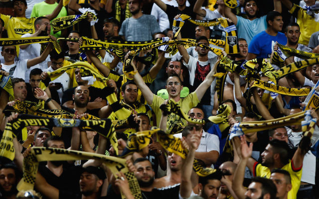 Beitar Jerusalem fans cheer ing at a match at Teddy Stadium in Jerusalem, July 23, 2015. (Yonatan Sindel/Flash90).