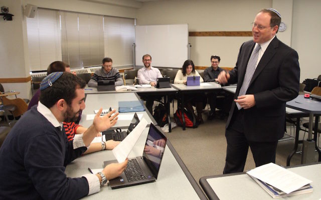 Rabbi Aaron Panken teaching a Talmud Class to Hebrew Union College students. JTA