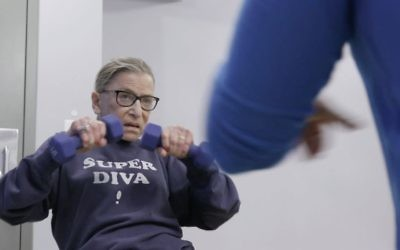 """Justice Ginsburg mid-workout routine in a scene from the 2018 documentary """"RBG."""" (Courtesy of Magnolia Pictures)"""