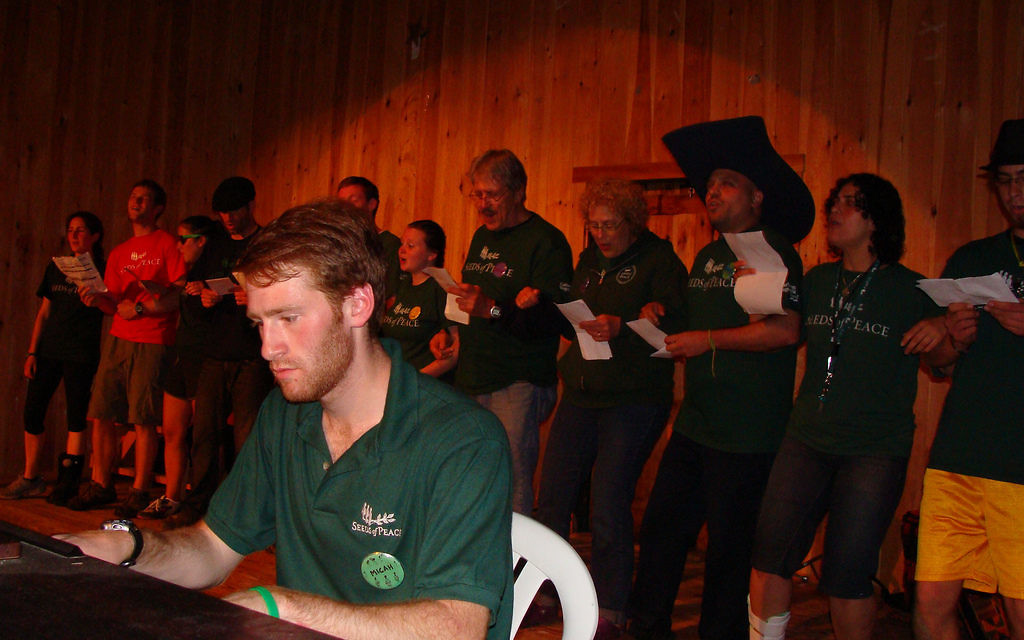 Micah Hendler at the piano at Seeds of Peace camp. Courtesy of Seeds of Peace