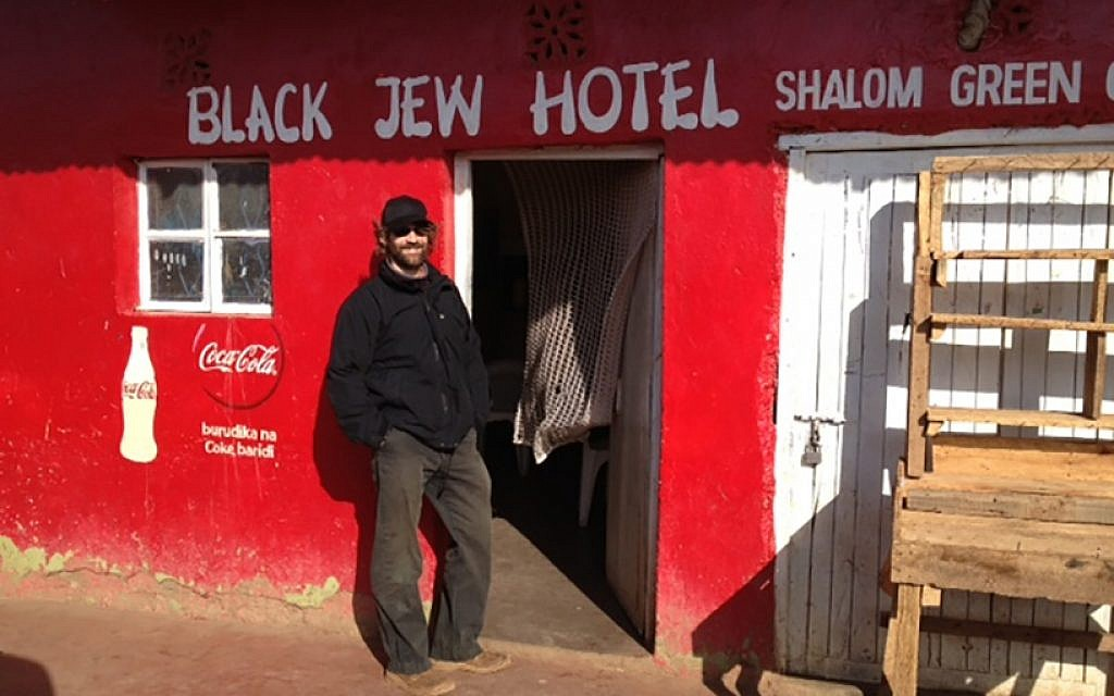 New York Times reporter Jeffrey Gettleman stands in front of the Black Jew Hotel in northern Kenya. (Via Times of Israel)