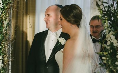 """Rachel and Andrew Leone under the chuppah: Aufruf blessing """"meant the world to us and me,"""" Rachel said."""