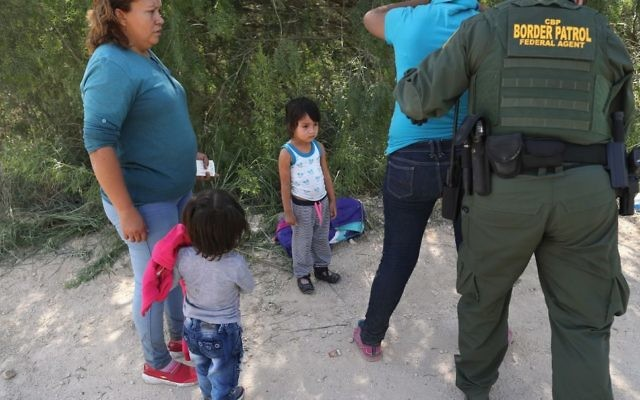 This image by John Moore of U.S. Border Patrol agents taking a Central American asylum seeker into custody, and separating the woman from her child, helped catalyze the response to the Justice Department's zero-tolerance policy. Getty Images