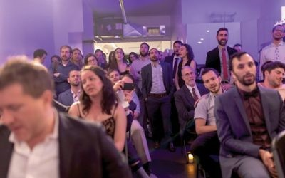 Basers singing along during the seven blessings part of the Base fundraising dinner last week. Courtesy of Johannes W. Berg/Base Hillel