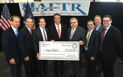 Gov. Andrew Cuomo, center, with officials at the Hebrew Academy of the Five Towns and the Rockaways at ceremony earlier this month marking state money for security improvements to schools and JCCs. Haftr.org