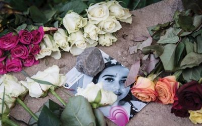 A picture of Susanna Maria Feldman was placed last week among flowers at a makeshift memorial in Wiesbaden, where the 14-year-old girl was allegedly raped and murdered by an Iraqi asylum seeker. Getty Images