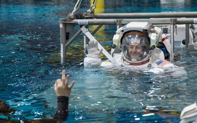 Jessica Meir doing space suit training at Johnson Space Center in Houston, Texas. (Bill Stafford/NASA)