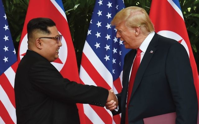 North Korean leader Kim Jong-un and President Trump shaking hands at  the start of their historic summit in Singapore.