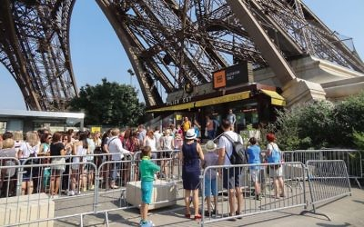 Tourists visiting the Eiffel Tower in Paris. Hit sites like this on off hours and book a slot in advance to avoid frustration, our travel writer suggests. Wikimedia Commons