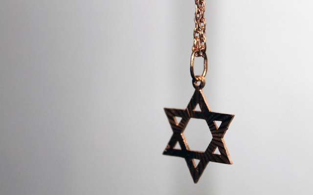 Isaac Goldin says his son was forced to remove his Star of David necklace. (Pixabay)