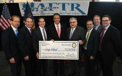 Gov. Andrew Cuomo with officials at the Hebrew Academy of the Five Towns and the Rockaways at ceremony earlier this month marking state money for security improvements to schools and JCCs.